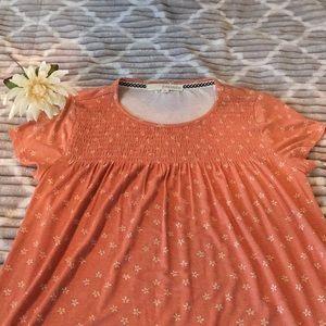 Woman's coral short sleeve shirt.